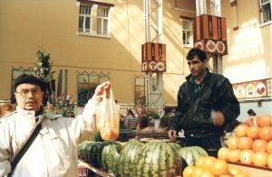 Kiev. Bessarabka market; citrus-seller. Year 1997.