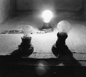 Light bulbs, one for each room, in the communal lavatory. Each bulb is connected to the meter in the respective room. Photo courtesy of Communal Living in Russia: A Virtual Museum of Soviet Everyday Life http://kommunalka.colgate.edu