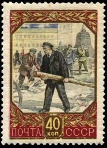 Soviet 1957 stamp immortalizes the scene where Lenin carries a log during community work on the Kremlin campus May 1, 1920. The picture on the stamp differs vastly from the original photograph. (Photo from traditio.wiki/Ленин_и_бревно).