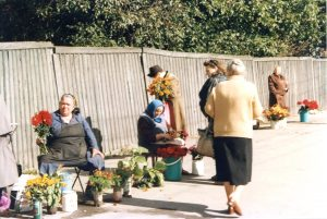 Flower mini-mart at the entrance to a cemetery. Kiev. Year 1997.